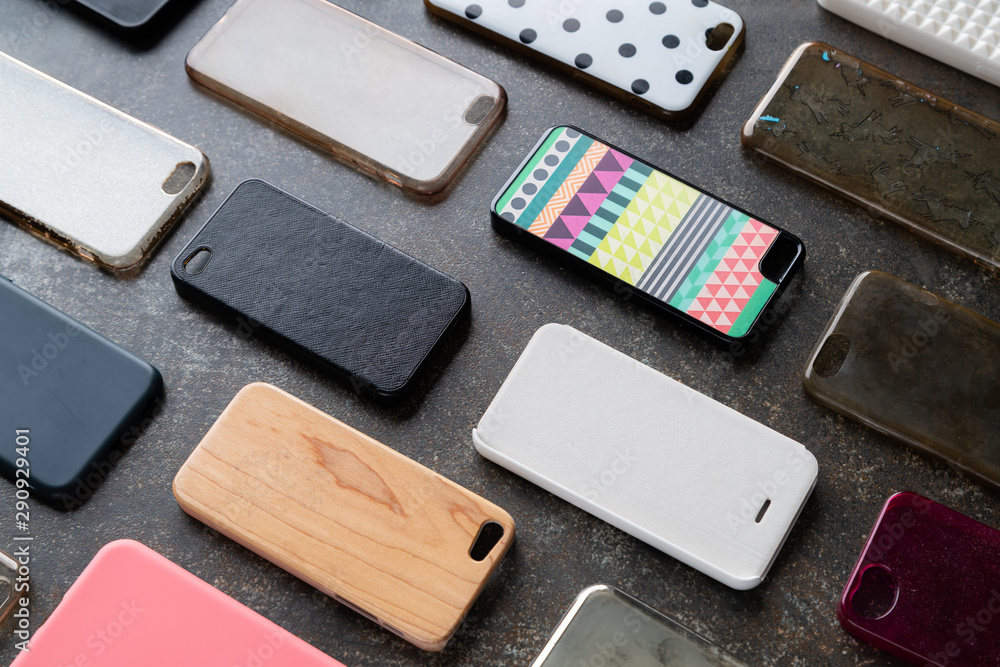 Fototapety, obrazy: Pile of multicolored plastic back covers for mobile phone. Choice of smart phone protector accessories background. A lot of silicone phone backs or skins next to each other