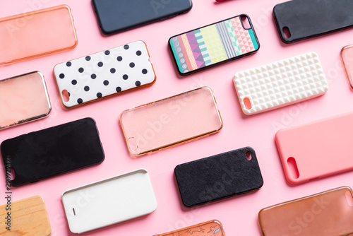 Obraz Pile of multicolored plastic back covers for mobile phone. Choice of smart phone protector accessories background. A lot of silicone phone backs or skins next to each other - fototapety do salonu