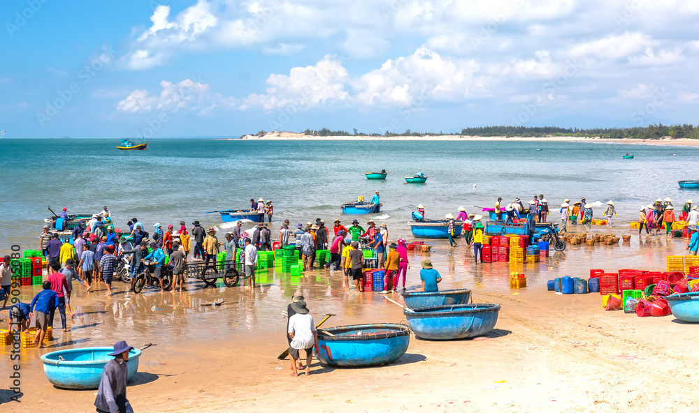 Fototapety, obrazy: Fish market session seas, people gathered inside basket fish sale, strenuous rowing fishermen fish brought ashore fishing village in Phan Thiet, Vietnam