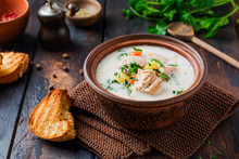 Warm Finnish Creamy Soup With Salmon And Vegetables In Old Ceramic Bowl On Old Wooden Background. Rustic Style.