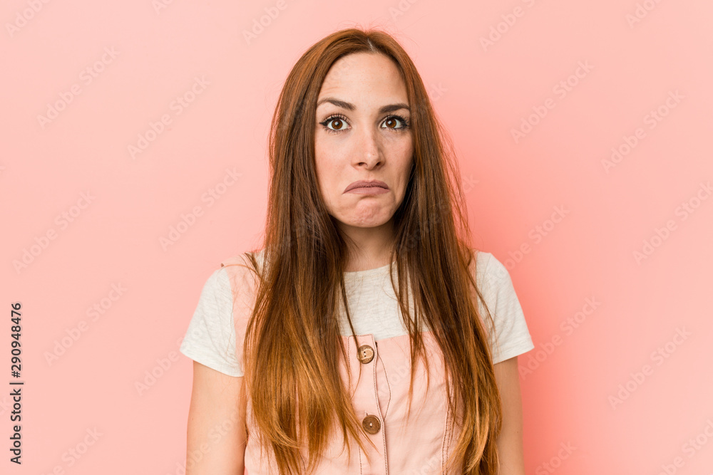Fototapety, obrazy: Young ginger woman with freckles shrugs shoulders and open eyes confused.