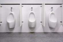 Row Of White Ceramic Urinal Ch...