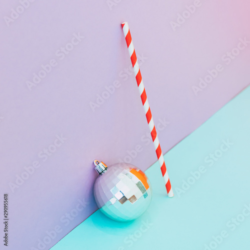 Photo sur Aluminium Pop Art Silver decoration ball with candy stick. Conceptual Christmas and New Year idea