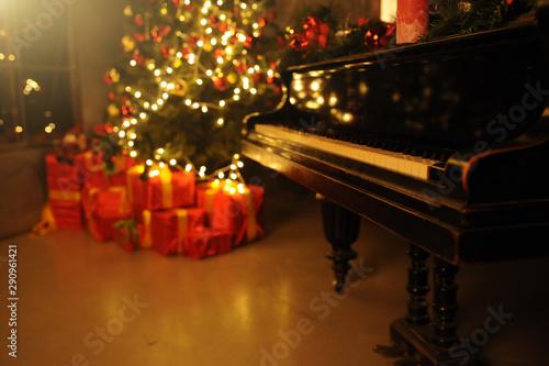 Evening christmas with christas tree and many gift box near piano Fototapeta