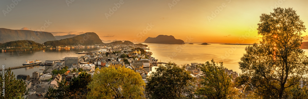 Fototapeta Alesund is a port and tourist city at the entrance to the Geirangerfjord.  Cityscape image of Alesund  at dawn.