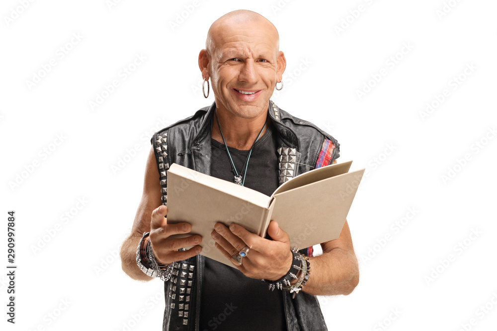 Fototapety, obrazy: Punker in leather vest holding a book and smiling at the camera