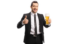 Cheerful Businessman Holding A...
