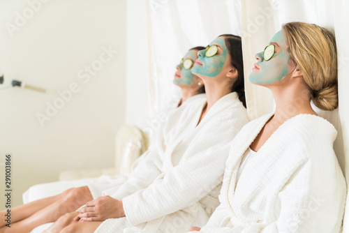 Valokuvatapetti Attractive Female Friends Relaxing With Facial Masks