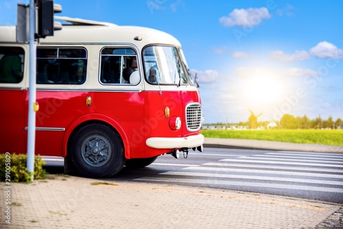 Bus traveling . the red bus in retro style . Tourism by bus in rural areas