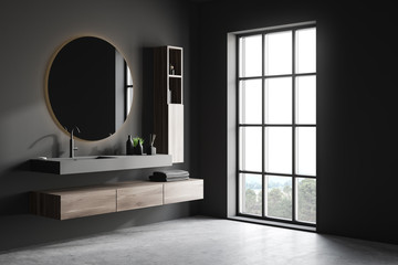 Gray bathroom corner with sink and mirror