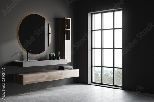 Photographie  Gray bathroom corner with sink and mirror