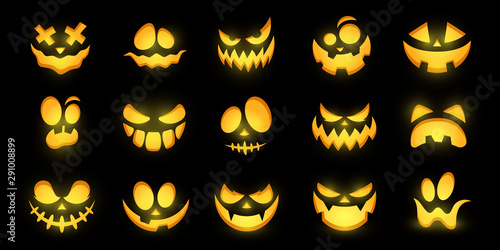 Photo  Scary and funny glowing faces of Halloween pumpkin or ghost