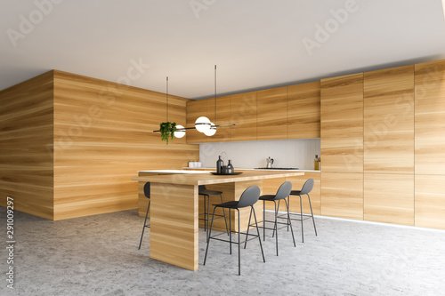 Photo  Wooden kitchen corner with bar and stools