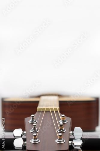 Vászonkép  An acoustic guitar headstock on white background.