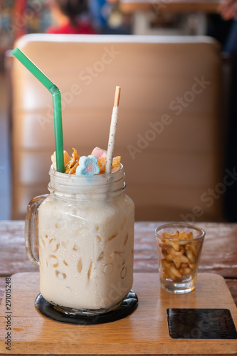 Milkshake with marshmallow, sweet cookies.