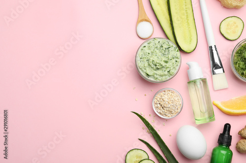 Flat lay composition with handmade face mask and ingredients on pink background. Space for text