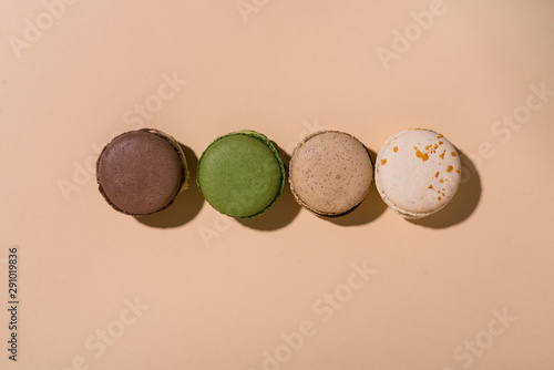 Set of four colorful french macaroons. Pattern flat lay