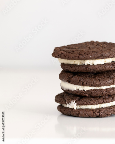 three chocolate and vanilla whoopie pies stacked on counter