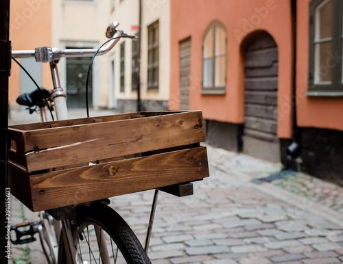 Türaufkleber Fahrrad vintage wooden basket on a bycicle on a cobbled street in Europe