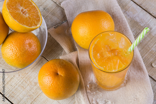 Orange juice with light bulb in glass cup