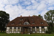 An Abandoned Country House With A Red Roof In East Germany.