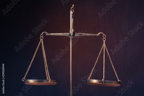 Foto op Plexiglas Historisch geb. Law scales on table. Symbol of justice