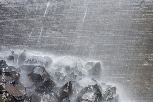 Stickers pour portes Taupe The Snow Waterfall waters falling in high volume on rocks