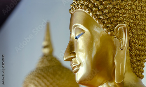 Foto op Plexiglas Historisch geb. Closeup of Head Buddha statue with golden used as amulets of Buddhism