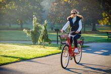 Urban Biking - Woman Riding Bi...