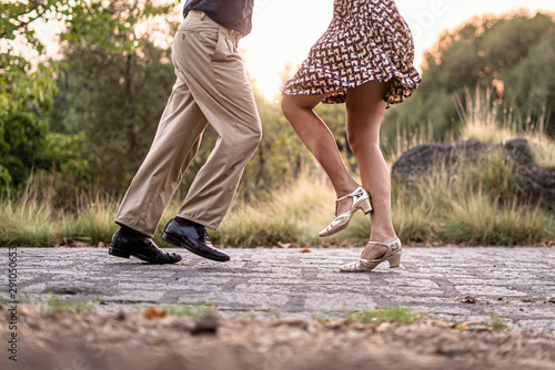 Two adult dancers feet dancing swing music outdoors in the park - unrecognizable people - 291050653