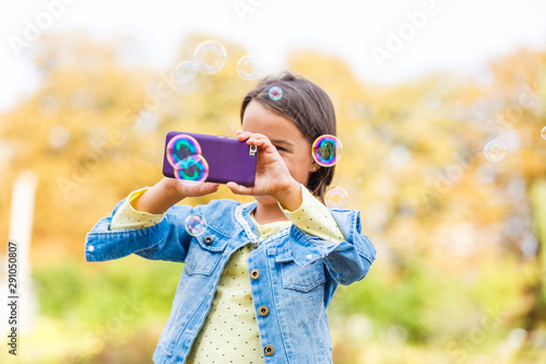 little girl in park in autumn, selfie photo Canvas Print