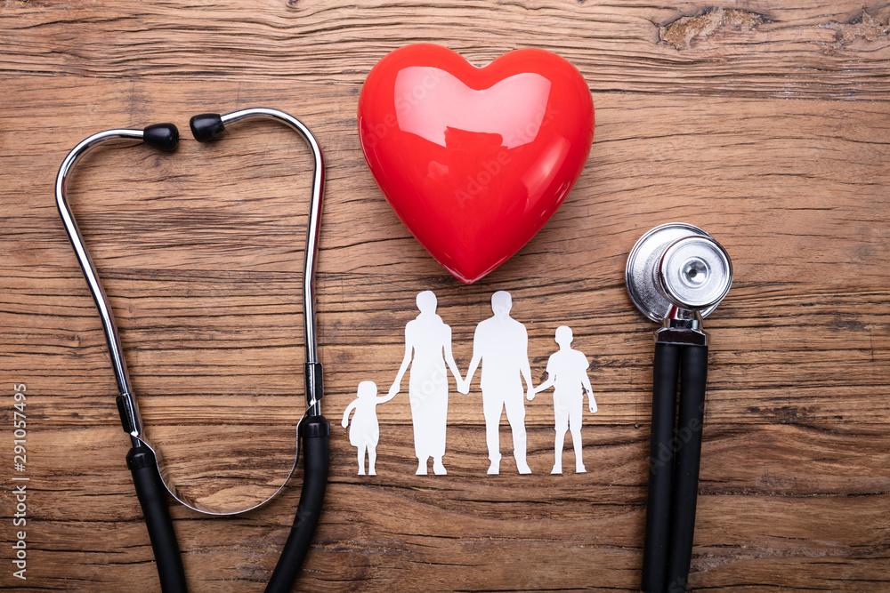 Fototapety, obrazy: Family Cut Out With Stethoscope And Red Heart On Desk