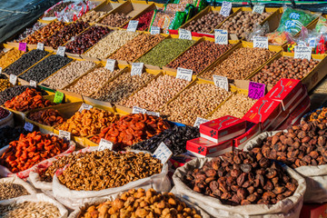 BISHKEK, KYRGYZSTAN - MAY 19, 2017: Dried fruits and nuts at the Osh bazaar in Bishkek, capital of Kyrgyzstan.