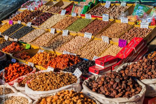 BISHKEK, KYRGYZSTAN - MAY 19, 2017: Dried fruits and nuts at the Osh bazaar in Bishkek, capital of Kyrgyzstan Wallpaper Mural