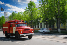 Red Fire Truck Rides On A City Street To Call.
