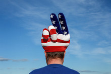 Man Wearing An American Patrioitic Peace Sign Hat With Stars And Stripes