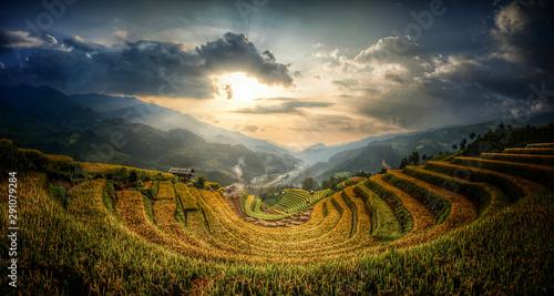 Fotobehang Rijstvelden Terraced rice fields that resemble the letter U. Sunset evening light and low light. at Mu Cang Chai in Vietnam.
