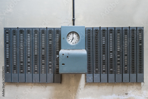 Symmetrical shot of an old mechanical timeclock found in an abandoned factory Wallpaper Mural