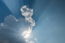 Crepuscular Rays (God Rays) And Cloud Shadow In The Sky