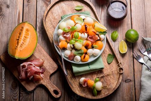 Melon, mozzarella, prosciutto appetizer or snack, summer salad with cantaloupe m Fototapeta