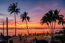 Stunning Sunset View With Palm Trees Reflecting In Swimming Pool In Luxury Island Resort In Thailand