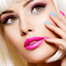 Face Of A Beautiful Woman With Pink Lips With Multicolor Nails.