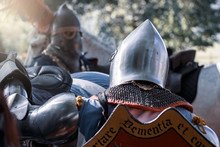 A Knight In A Helmet With A Fe...