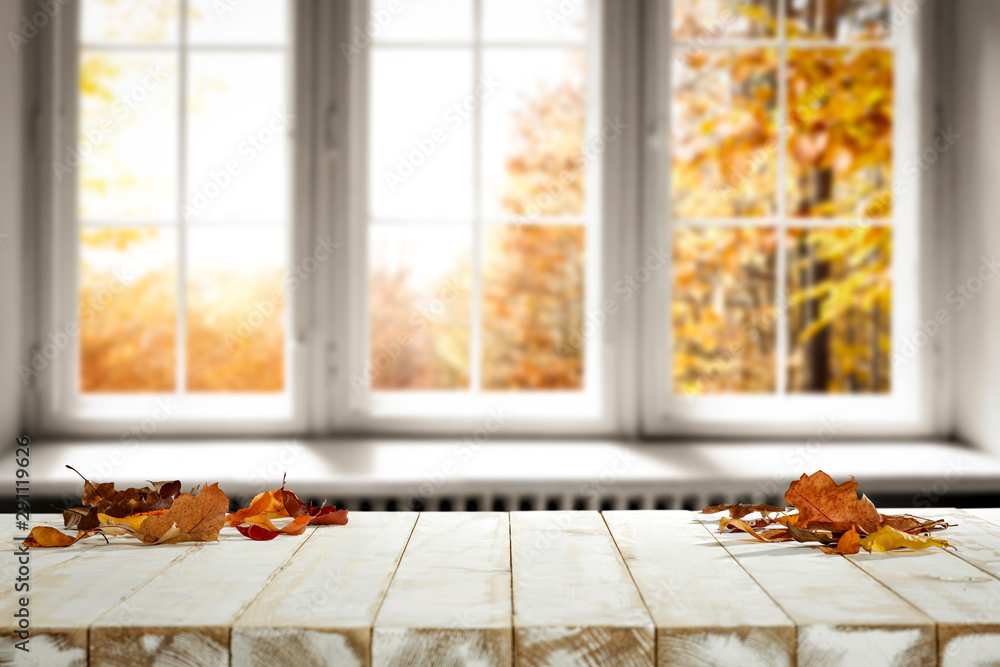 Fototapeta Fall wooden window sill and free space for your decoration.