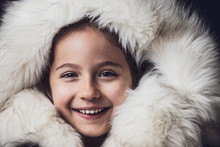 Close Up Portrait Of A Young Girl Dressed With An Eskimo Jacket  Looking At The Camera