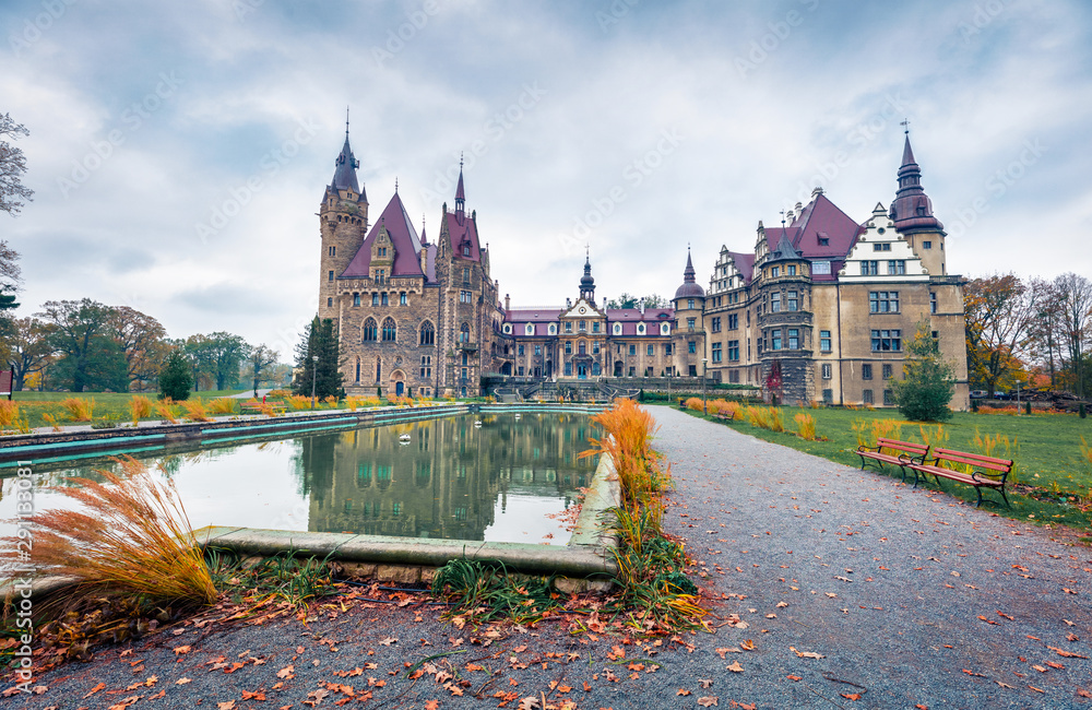 Fototapeta MOSZNA, POLAND - OCTOBER 24, 2017 ; The Moszna Castle, built in the XVII century, extended from 1900 to 1914, is a historic palace in Moszna, is one of the best known monuments in Upper Silesia.