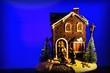 Leinwanddruck Bild - christmas house on blue background
