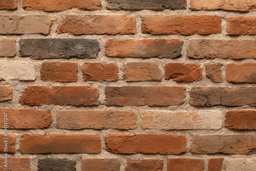 Fototapeta Elevated view of brown and red flame brick wall