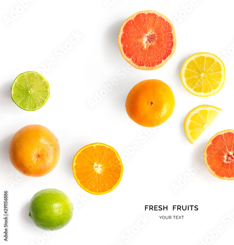 Creative layout made of lemon, lime, orange and grapefruit. Flat lay. Food concept. Lemon, lime, orange and grapefruit on white background.