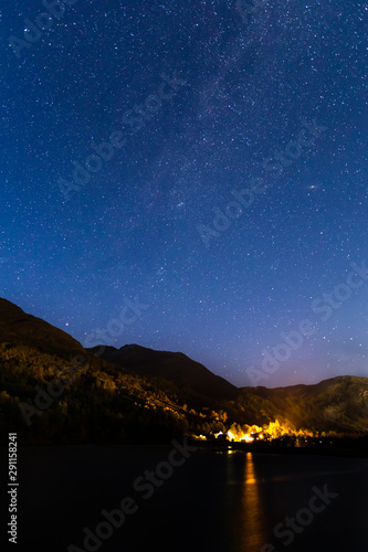 Foto auf Gartenposter Nordlicht stars glowing over loch leven in the argyll region of scotland near kinlochleven and fort william in the highlands during a clear blue autumnal night